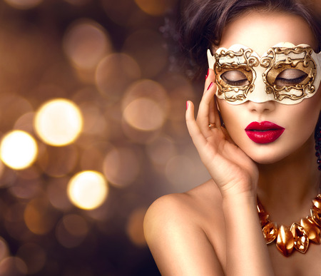 Foto de Beauty model woman wearing venetian masquerade carnival mask at party. Christmas and New Year celebration - Imagen libre de derechos
