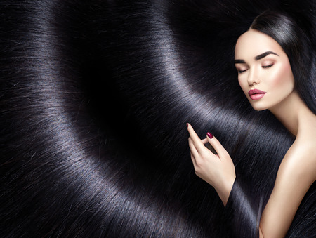 Photo pour Long hair background. Beauty brunette woman with straight black hair - image libre de droit