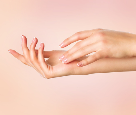 Photo pour Beautiful woman hands. Spa and manicure concept. Female hands with french manicure - image libre de droit