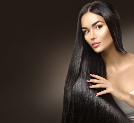 Foto de Beautiful long hair. Beauty model girl touching healthy hair - Imagen libre de derechos