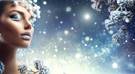 Foto de Christmas beauty girl. Winter holiday makeup with gems on lips - Imagen libre de derechos