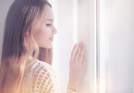 Photo for Young beauty romantic woman looking out the window - Royalty Free Image