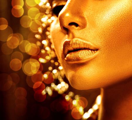 Photo pour Beauty model girl with golden skin. Fashion art portrait - image libre de droit
