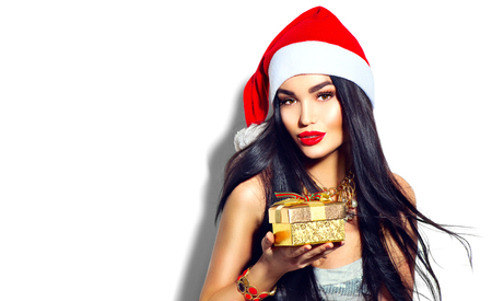 Foto de Beauty Christmas fashion model girl holding golden gift box - Imagen libre de derechos