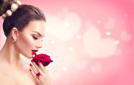Photo pour Valentine's day. Woman with red rose. Fashion model girl face portrait - image libre de droit