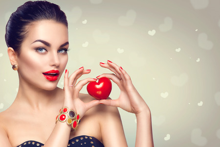 Photo for Fashion woman with red heart. Valentine's day art portrait. Beautiful makeup and manicure - Royalty Free Image
