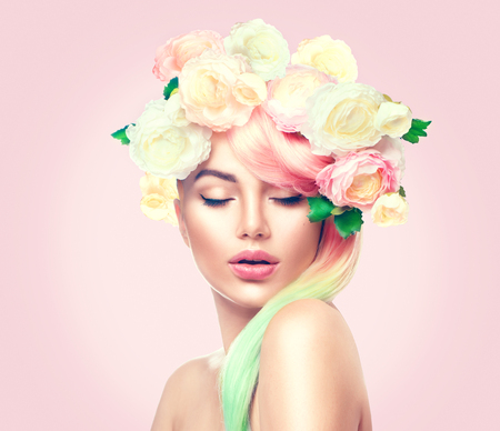Foto de Beauty summer model girl with colorful flowers wreath. Flowers hair style - Imagen libre de derechos