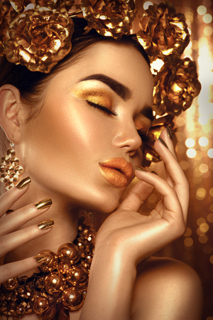 Photo for Golden holiday makeup. Golden wreath and necklace. Fashion art hairstyle, manicure and makeup - Royalty Free Image