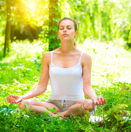 Photo for Yoga. Young woman doing yoga exercises outdoors. Meditation - Royalty Free Image