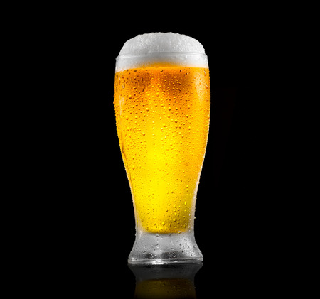 Foto de Beer. Glass of cold beer with water drops. Craft beer isolated on black background - Imagen libre de derechos