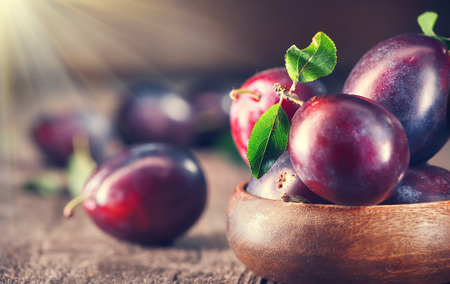 Photo for Plum. Juicy ripe organic plums closeup, over wooden background - Royalty Free Image