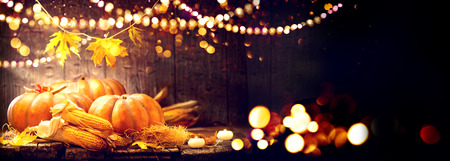 Foto de Thanksgiving Day background. Wooden table decorated with pumpkins and corncobs - Imagen libre de derechos