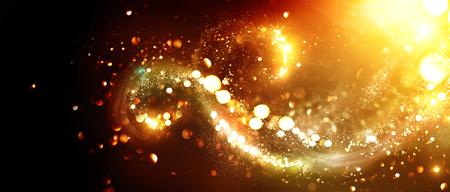 Photo for Christmas background. Golden glittering stars swirls over black background - Royalty Free Image