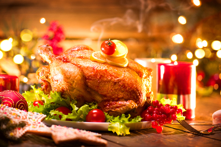 Foto de Christmas holiday dinner. Served table with roasted turkey - Imagen libre de derechos