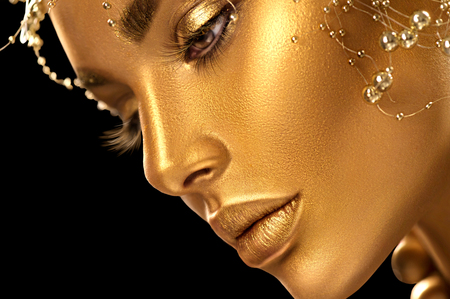 Photo pour Beauty model girl with holiday golden shiny professional makeup closeup portrait. Gold jewelry and accessories - image libre de droit