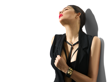Photo pour Portrait of sexy young woman in black clothes isolated on white background - image libre de droit