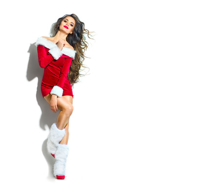 Photo for Christmas scene. Sexy Santa. Beauty model girl wearing red party costume - Royalty Free Image