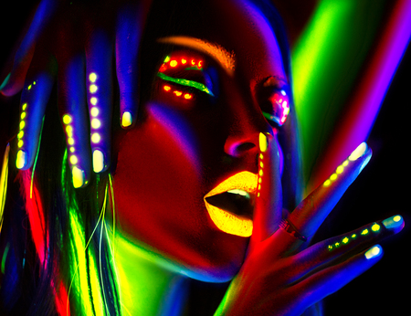 Photo for Fashion model woman in neon light. Portrait of beautiful model girl with colorful fluorescent makeup - Royalty Free Image