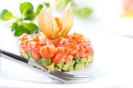 Photo for Salmon tartar over white background. Gourmet Food. Starter. Healthy dinner - Royalty Free Image