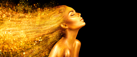 Photo pour Fashion model woman in golden bright sparkles. Girl with golden skin and hair portrait closeup. Holiday glamour shiny professional makeup on black - image libre de droit