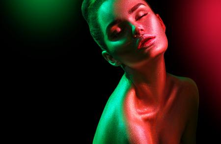 Photo pour Fashion model woman in colorful bright sparkles and neon lights posing in studio, portrait of beautiful sexy girl. Art design colorful vivid makeup - image libre de droit
