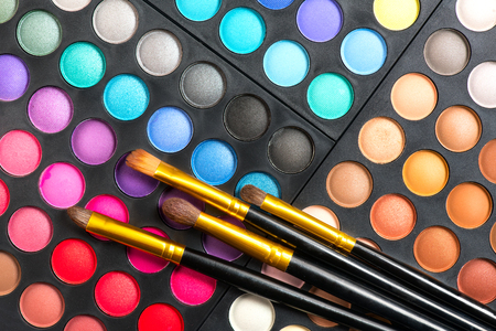 Photo for Makeup set. Professional multicolor make up eyeshadows palette and brushes, bright vivid colors and tints of eye shadows set background - Royalty Free Image