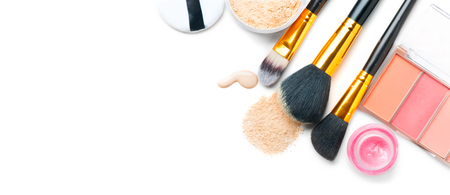 Foto de Cosmetic liquid foundation or cream, loose face powder, various brushes for apply makeup. Make up concealer smear and powder isolated on a white background. Products for professional face skin makeup - Imagen libre de derechos