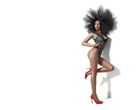 Foto de Beauty model girl in swimsuit, Swimwear. Slim sexy woman posing on white - Imagen libre de derechos