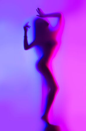 Photo pour Beauty Model girl dancing silhouette. Beautiful sexy young woman with perfect slim body dancing in colorful uv neon lights. - image libre de droit
