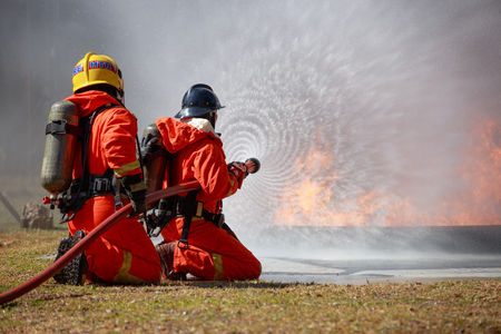 Foto per Firefighters are fighting fire with a  fire brigade - Immagine Royalty Free