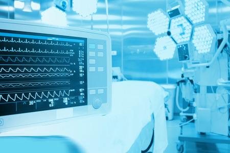 Foto de Monitoring of patient in surgical operating room in modern hospital - Imagen libre de derechos