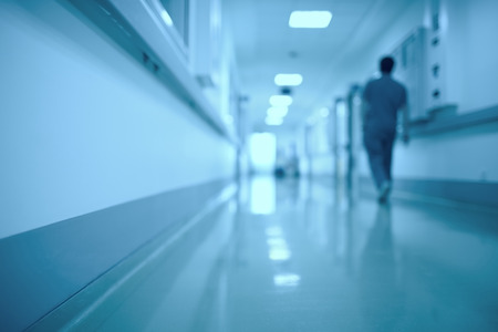Foto de Blurred medical background. Moving human figure in the hospital corridor - Imagen libre de derechos
