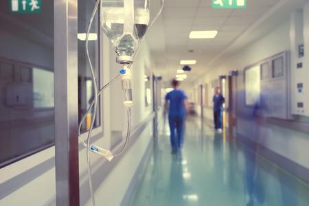 Foto de Medical drip in hospital corridor. - Imagen libre de derechos
