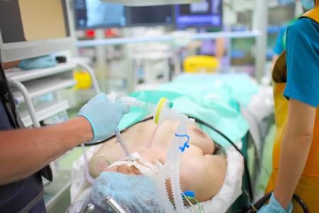 Foto de Unconscious patient connected to the ventilator in the x-ray operating theatre. - Imagen libre de derechos
