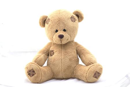 Photo pour Brown teddy bear on white background. - image libre de droit