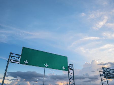 Foto de Big Traffic guide post on top of the road with idyllic sky and white cloud in the city,mock up - Imagen libre de derechos