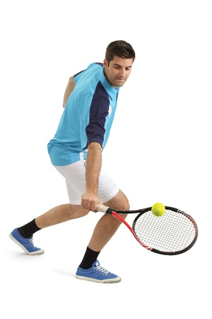 Photo of an attractive male tennis player hitting the tennis ball.