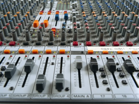 Photo for Photo of a recording studio mixer showing faders. - Royalty Free Image