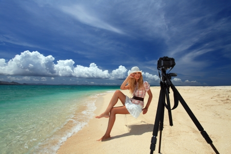young woman making photo using slr