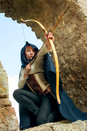 Photo for Ancient female archer with bow and arrow - Royalty Free Image