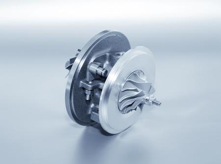 Foto de Turbocharger on metallic background. Car turbine - part of engine. Blue toned - Imagen libre de derechos
