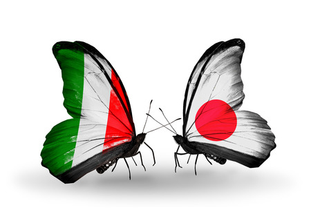 Photo for Two butterflies with flags on wings as symbol of relations Italy and Japan - Royalty Free Image