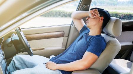 Foto de Asian young man sleeping in his car. - Imagen libre de derechos