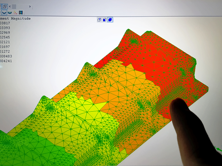 Photo for Finger Pointing at Computer Screen with Finite Element Analysis Result - Royalty Free Image
