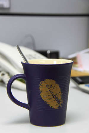 Office equipment in a cup of coffee
