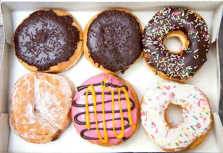 Box full of doughnuts, half a dozen donuts.