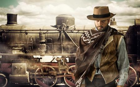 Photo pour Gunfighter of the wild west at the train station. - image libre de droit