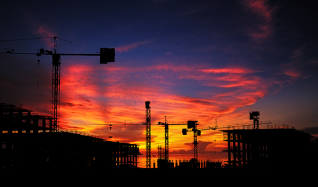 Photo pour Silhouette construction site with beautiful sunset sky background. Abandon building with sunset background. - image libre de droit