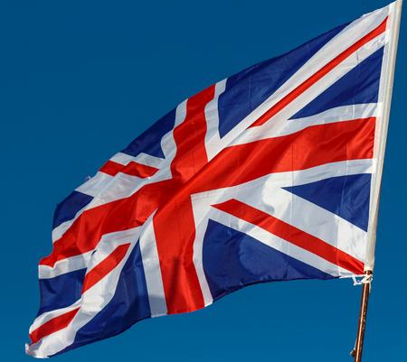Foto de Great Britain Flag with wrinkles and seams expanded in the breeze - Imagen libre de derechos
