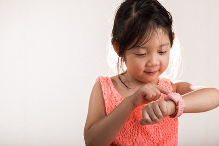 Foto per Child with Smartwatch. Child Using Smartwatch Background - Immagine Royalty Free